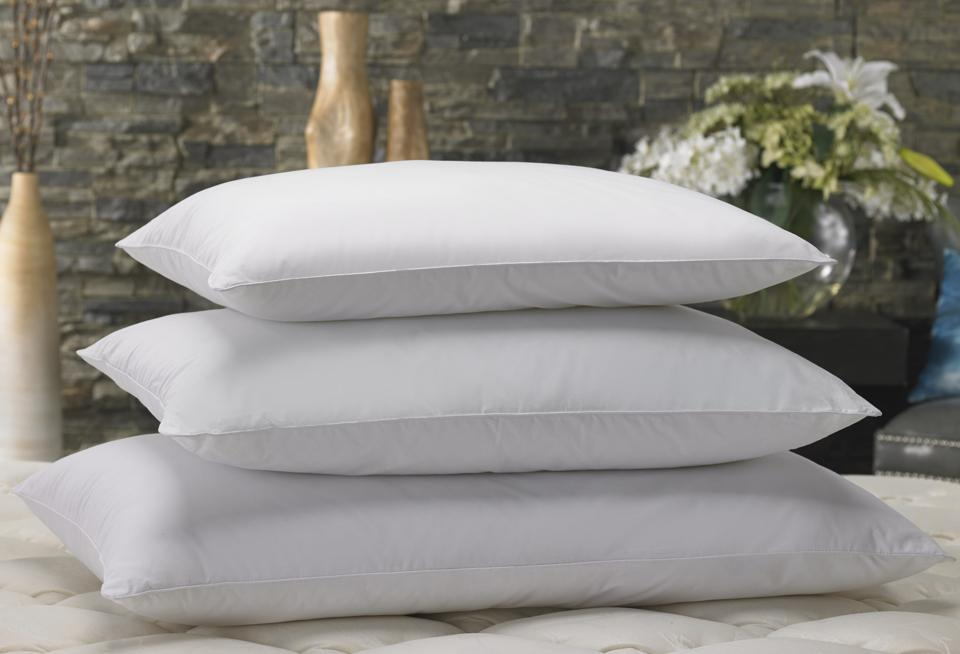 white pillows on mattress