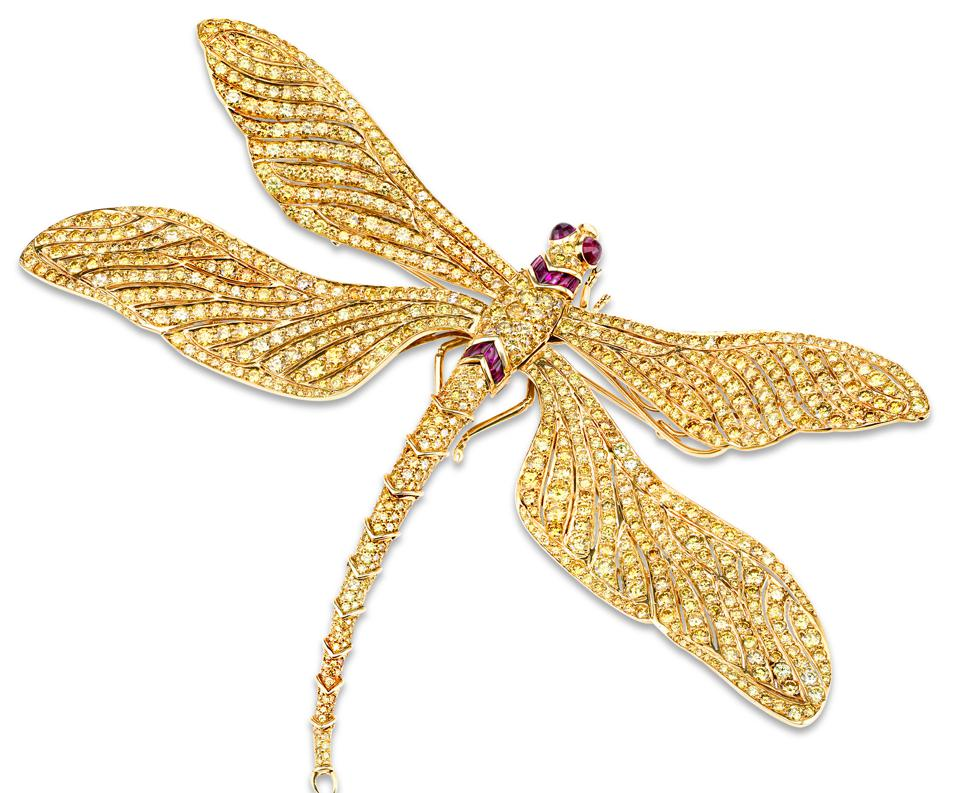 M.S. Rau offers a Fancy Vivid Yellow diamond dragonfly brooch, which was commissioned for billionaire John Kluge's wife by Fred Leighton and made by Carvin French.