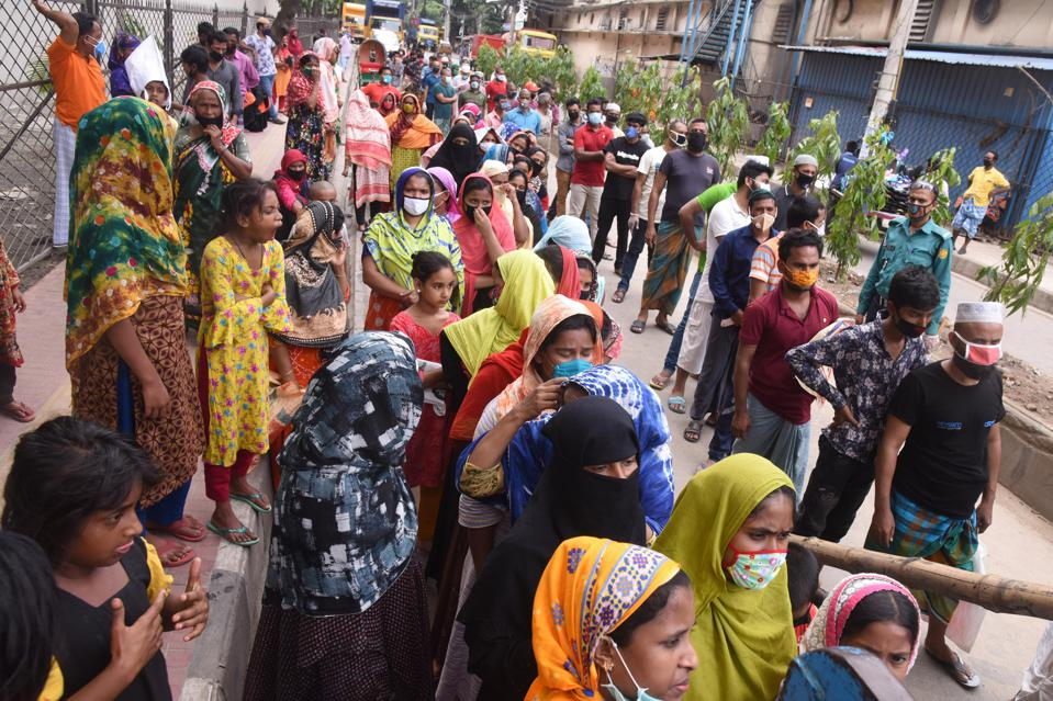 People in Bangladesh wait to collect handouts.