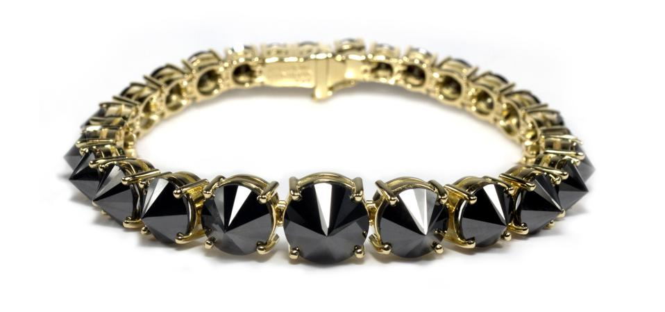 The tennis bracelet subverted, with black, inverted diamonds, by Ara Vartanian