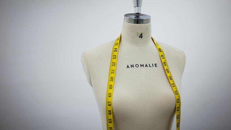An Anomalie mannequin with a tape measure draped over it.