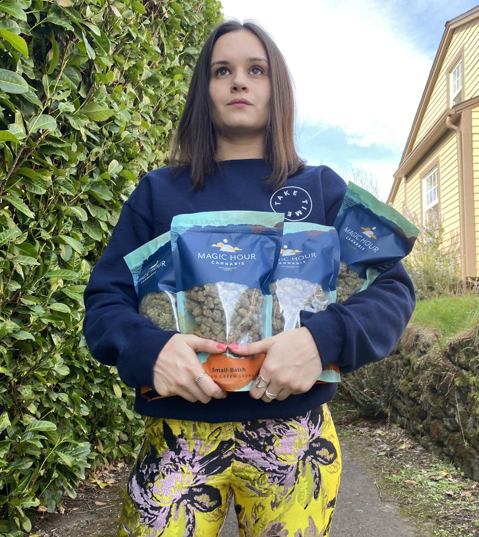 Owner Adriana Ruiz Carlile holding Magic Hour Cannabis mylar bags en route to a drop off