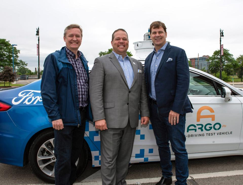 Peter Rander, President of Argo AI; Bryan Barnett, Mayor of Rochester Hills, MI; and Jim Farley,  COO of Ford