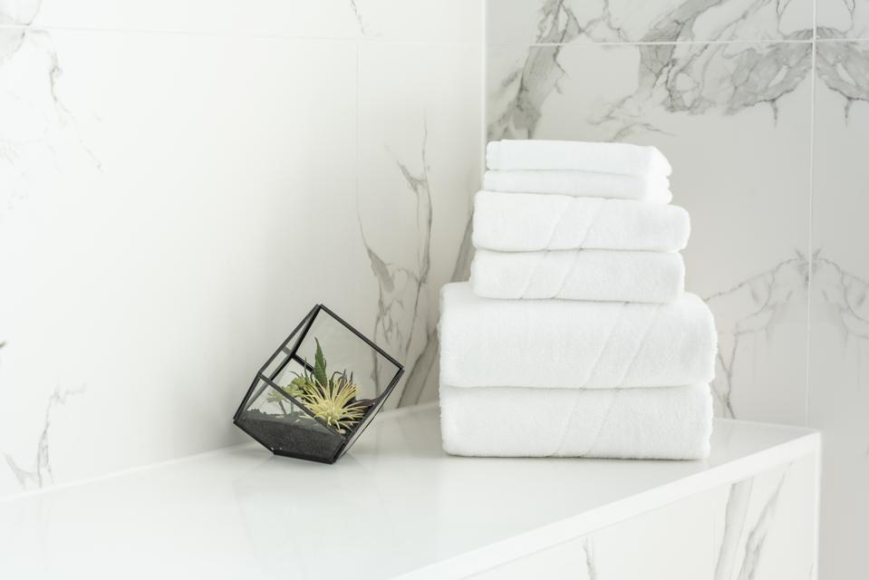 white towels on marble counter