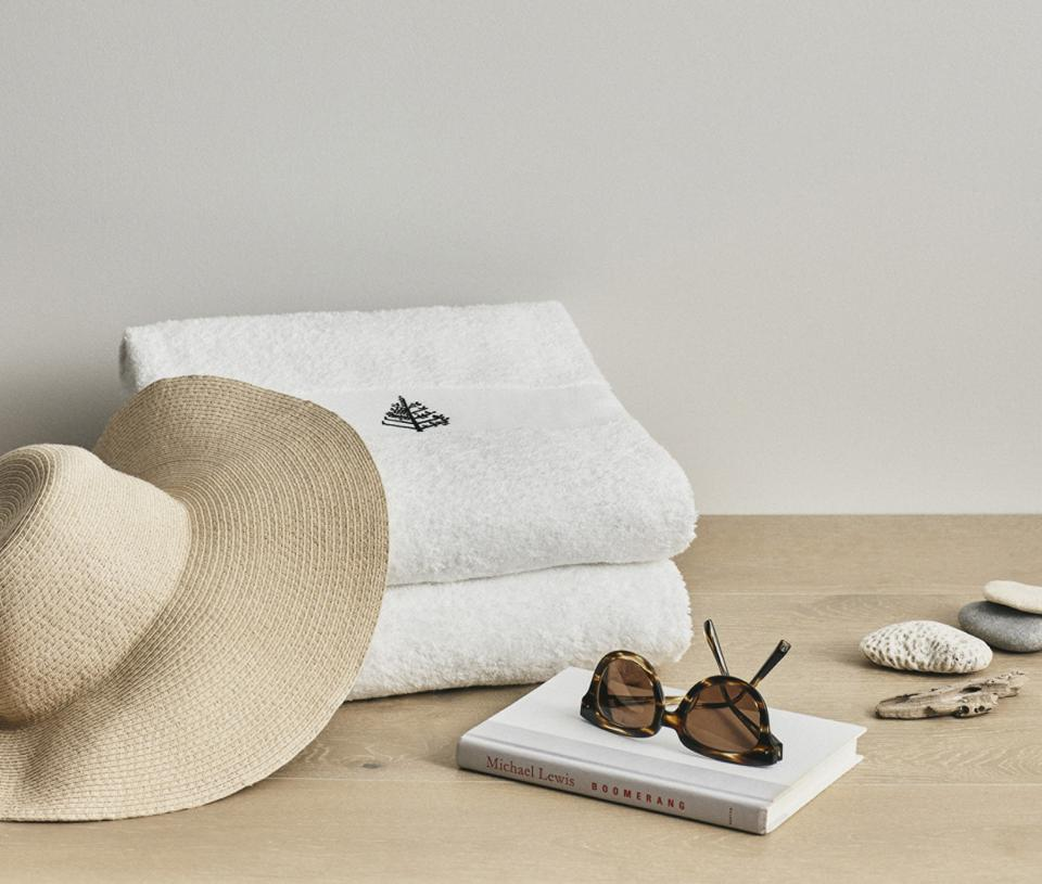 white pool towels with beach accessories