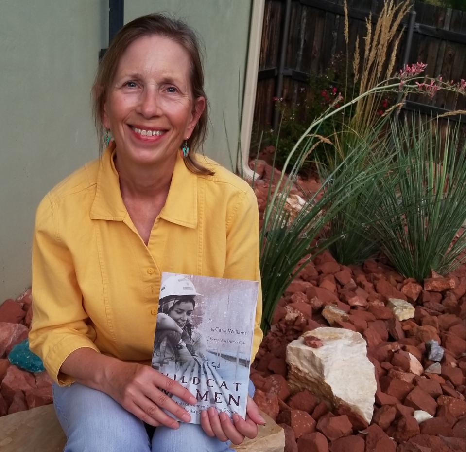 Author Carla Williams with her book.