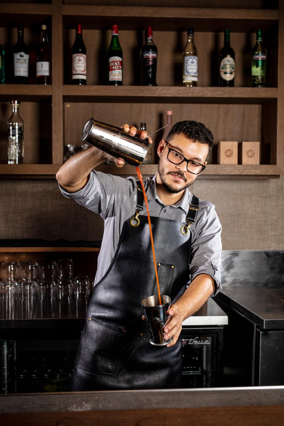 Bartender Joshua Lopez at work