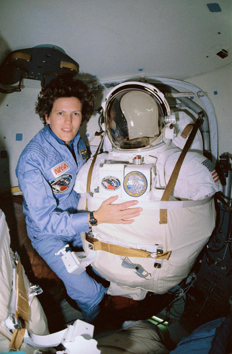 Kathryn Sullivan posed for this photograph as she prepared for a potential third spacewalk aboard STS-31, during which the Discovery crew deployed the Hubble Space Telescope.