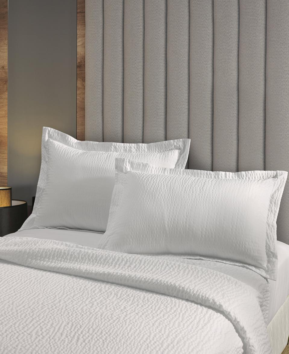 white textured coverlet and 2 shams