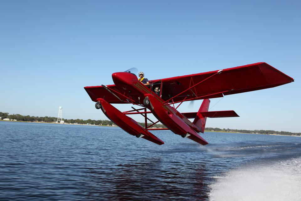 red seaplane taking off