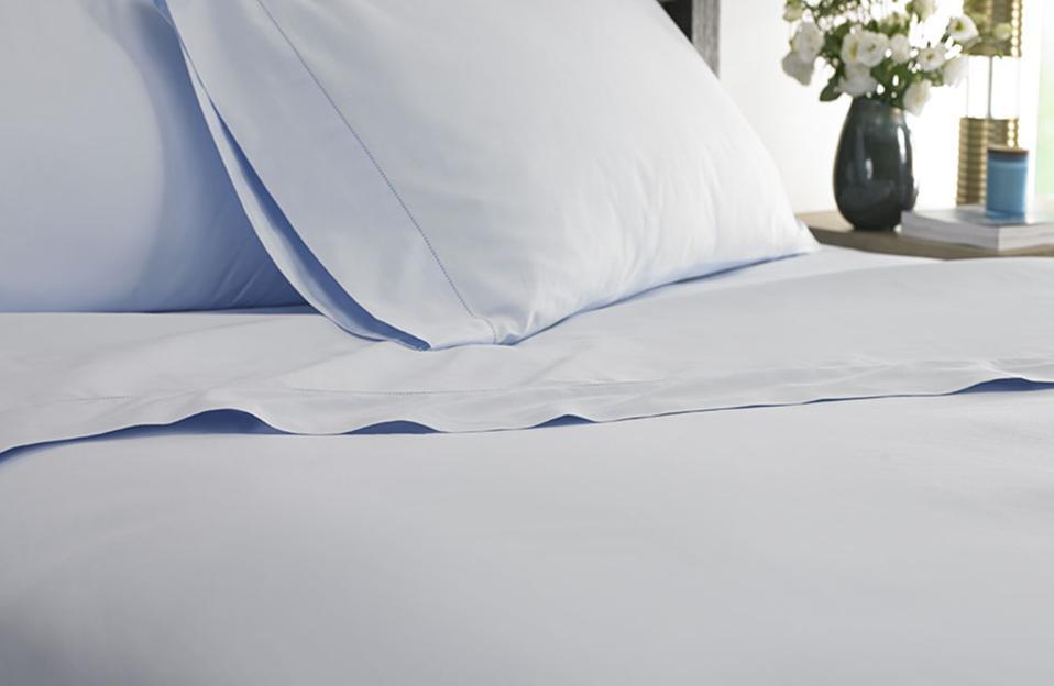 The Marriott blue Hemstitch sheet sets.