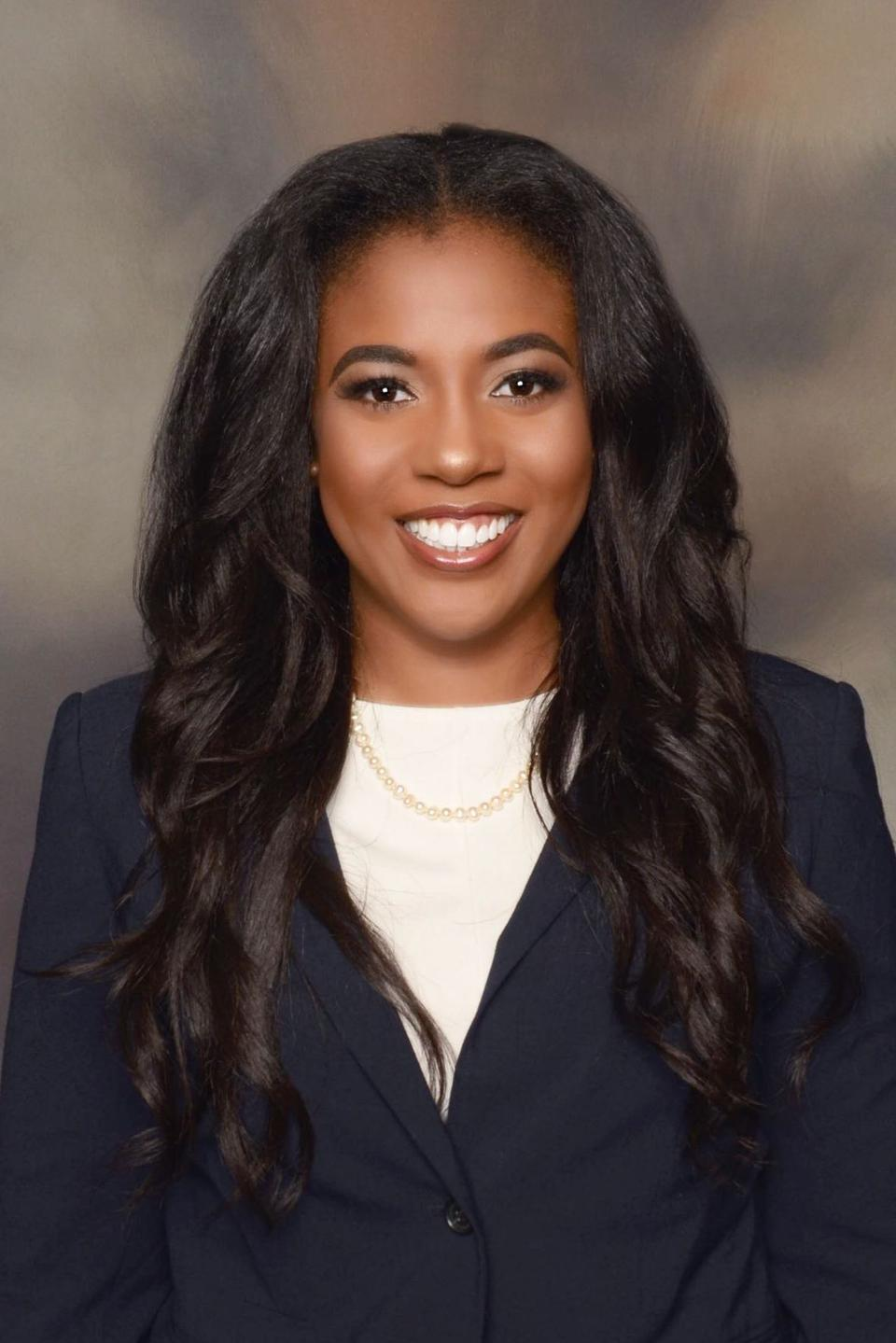 Headshot of Amber Hardeman in front of gray background.