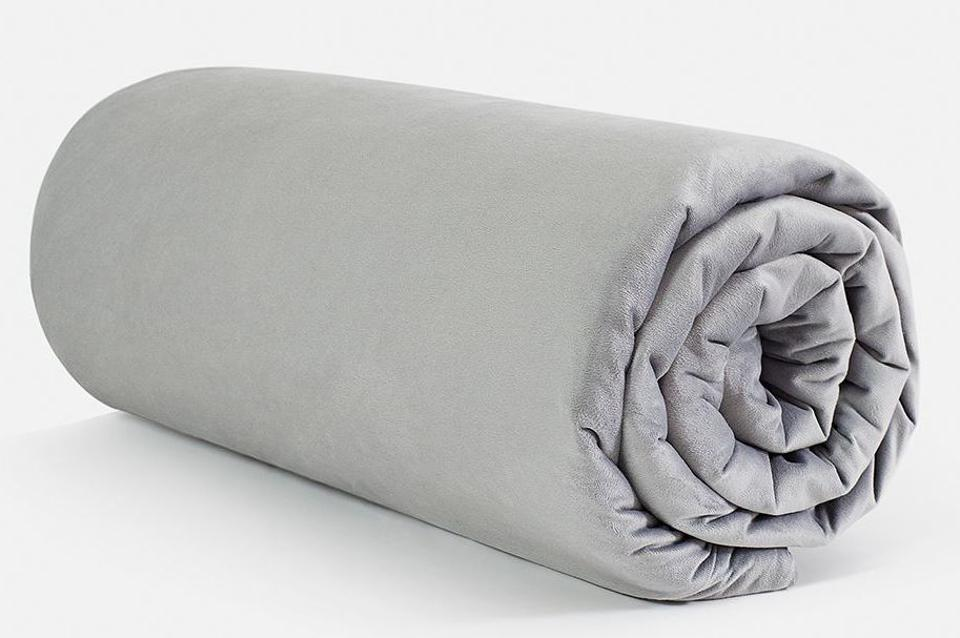 A rolled up Helix Weighted Blanket in grey