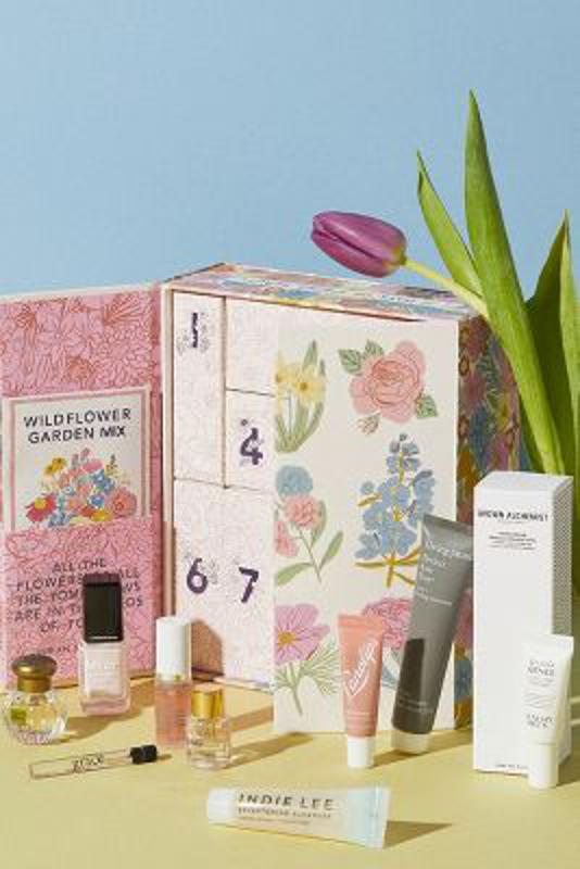 Boxed gift set featuring ten beauty samples in pretty packaging decorated with flowers