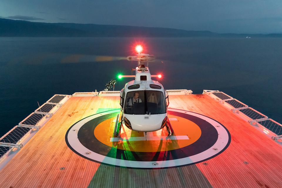 A helicopter prepares for lift off on a Pelorus superyacht expedition.