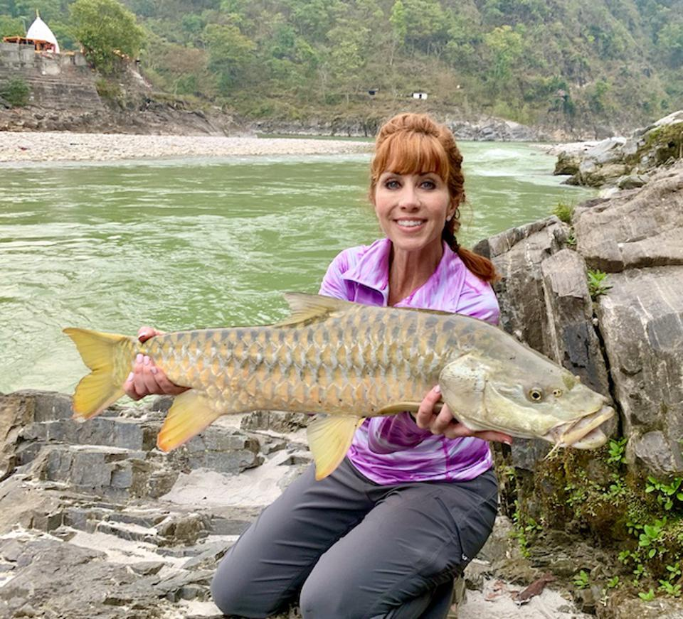 A golden mahseer Anietra caught and released at the camp