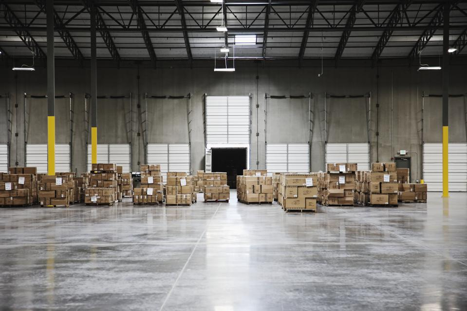 Cardboard boxes at loading dock in warehouse