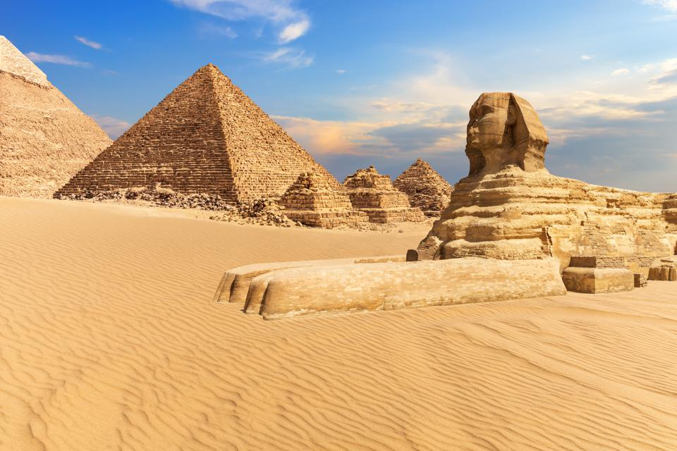 The Sphinx of Giza next to the Pyramids in the desert, Egypt