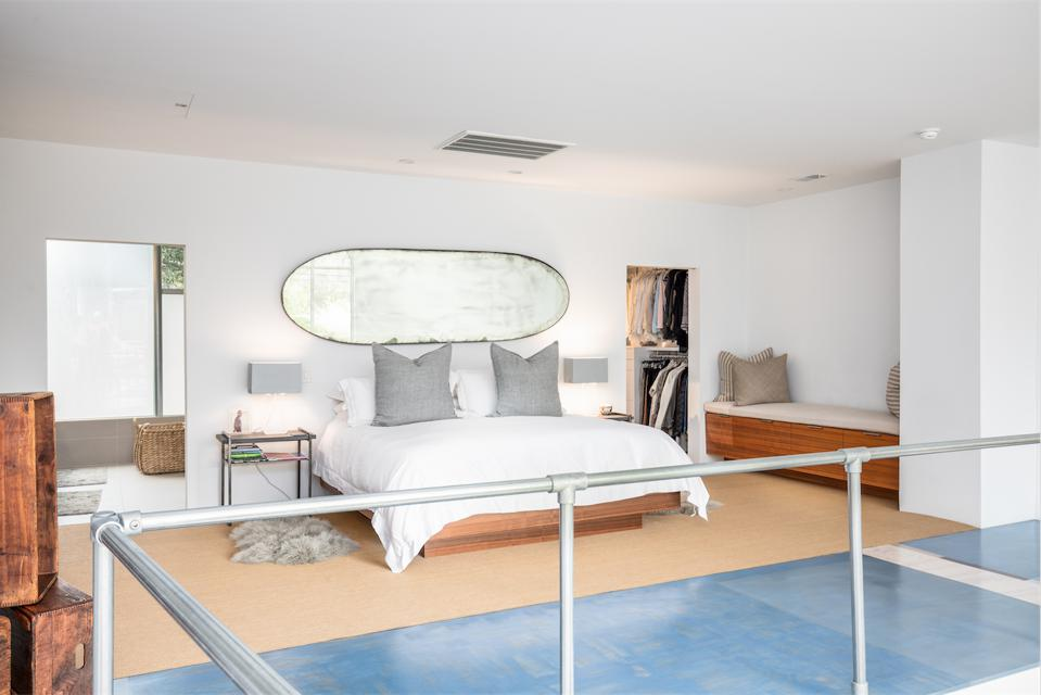 The entire second floor is designed as a singular master suite that floats high above the living area.