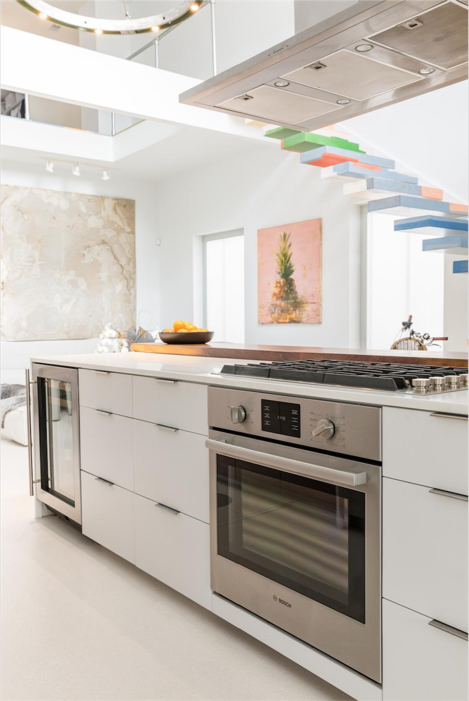 Contemporary kitchen with soaring 25-foot ceiling.