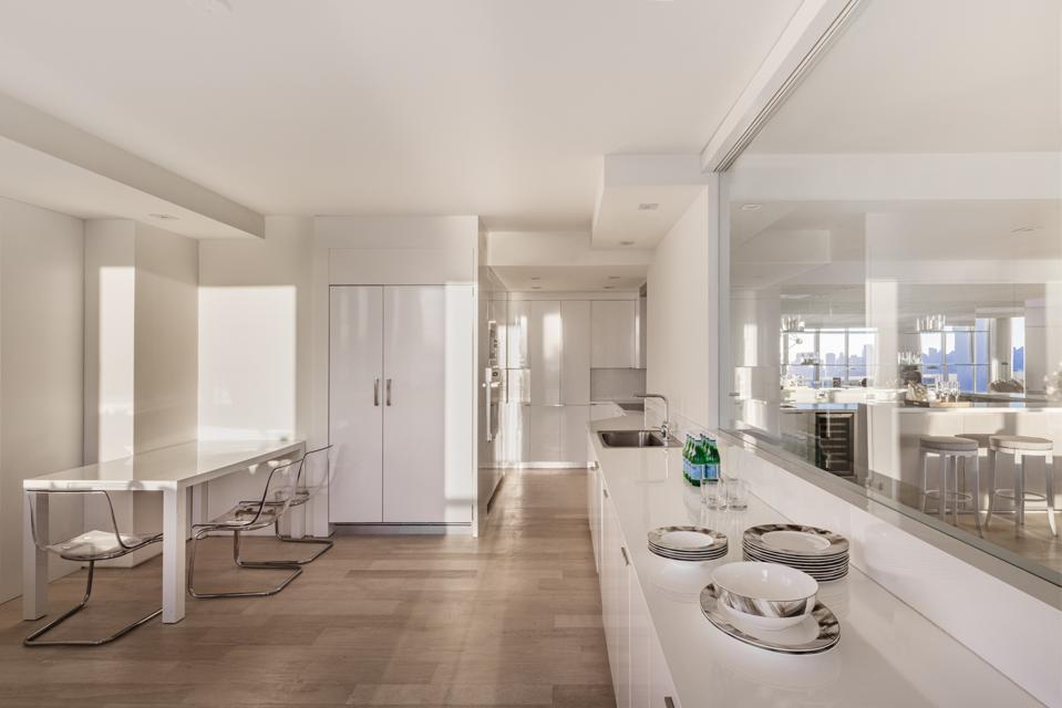 Immaculate white minimalist chef's chef's kitchen