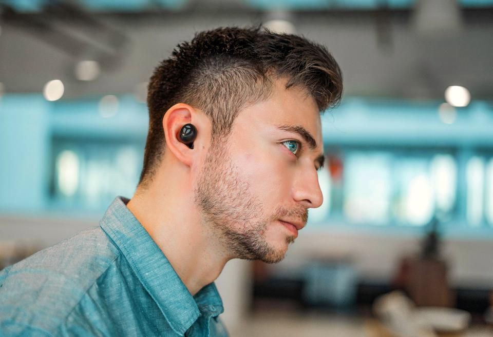 Man wearing Tranya Rimor earphones