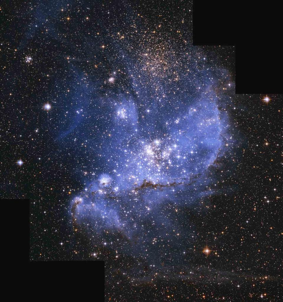 """""""A myriad of beautiful jewels nestling in a blue, glowing silk pillow,"""" writes Westmoquette about NGC 346: the young, star-forming nebula in the Small Magellanic Cloud—one of our closest neighbouring galaxies—as captured by the Hubble Space Telescope."""