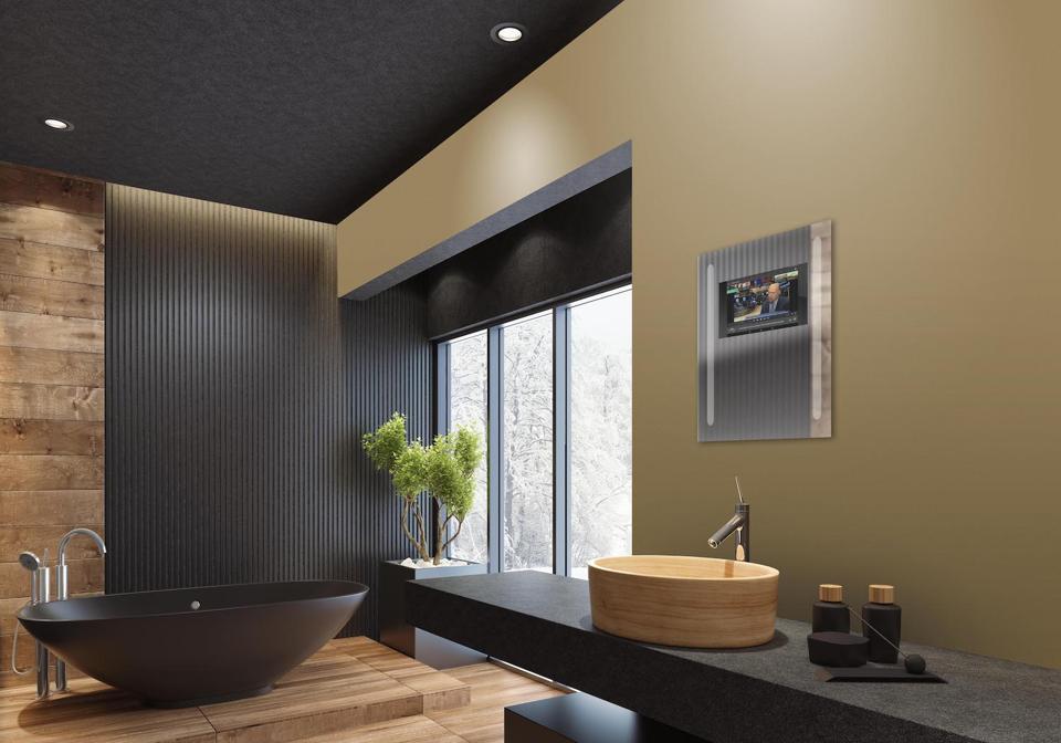 This luxury villa minimalist black bathroom has the new capstone mirror with integrated internet function.
