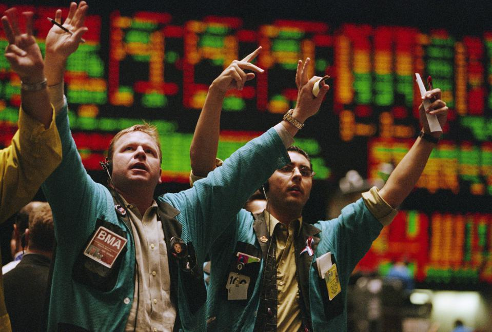 Traders waving arms on Exchange floor