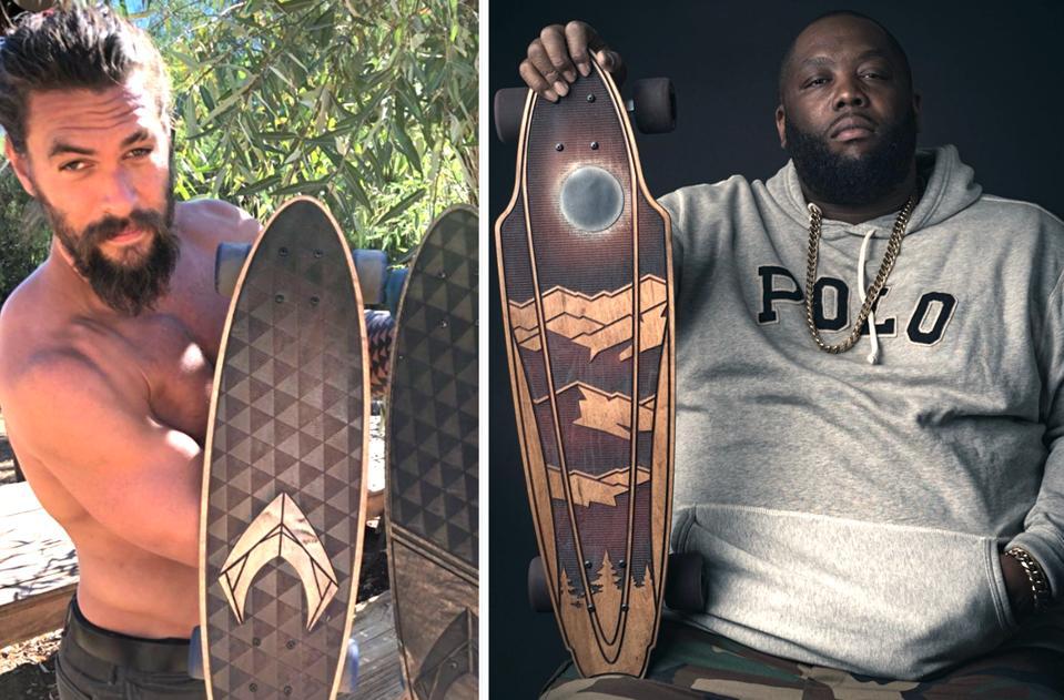 Actor Jason Momoa (l) and rapper Killer Mike with their custom Bear Walker decks.