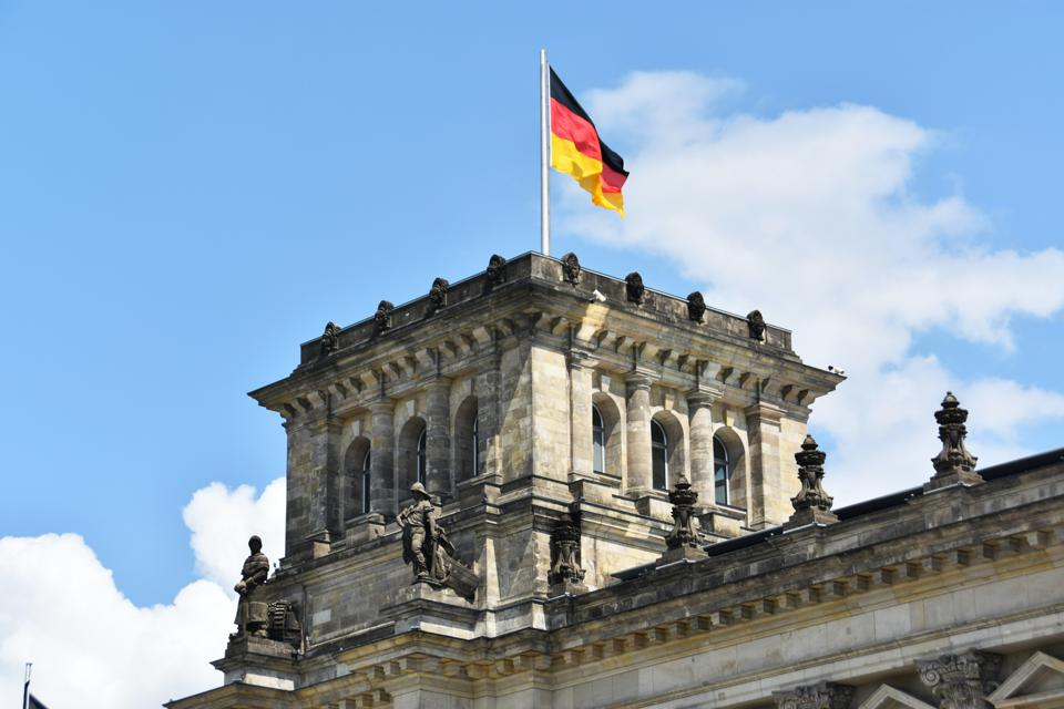 The Reichstag building with German flag