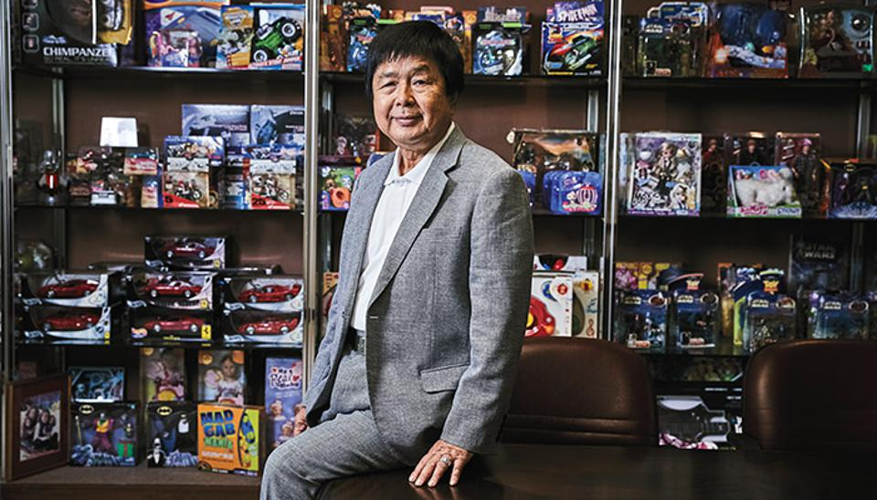 Francis Choi next to some of the many toys he's produced over the years. Now he's hoping to make such toys eco-friendly as well as fun to play with.