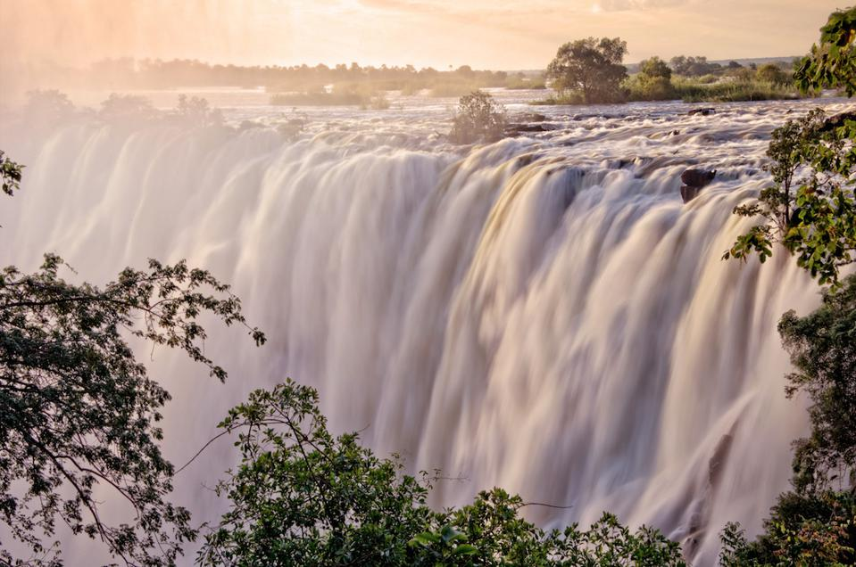 A view of Victoria Falls at sunset.
