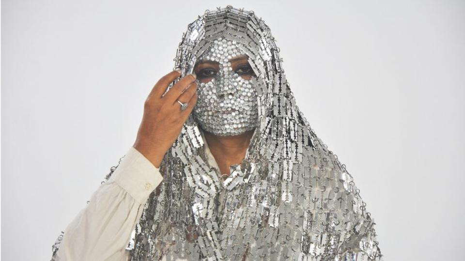Artists image of woman in razor hijab