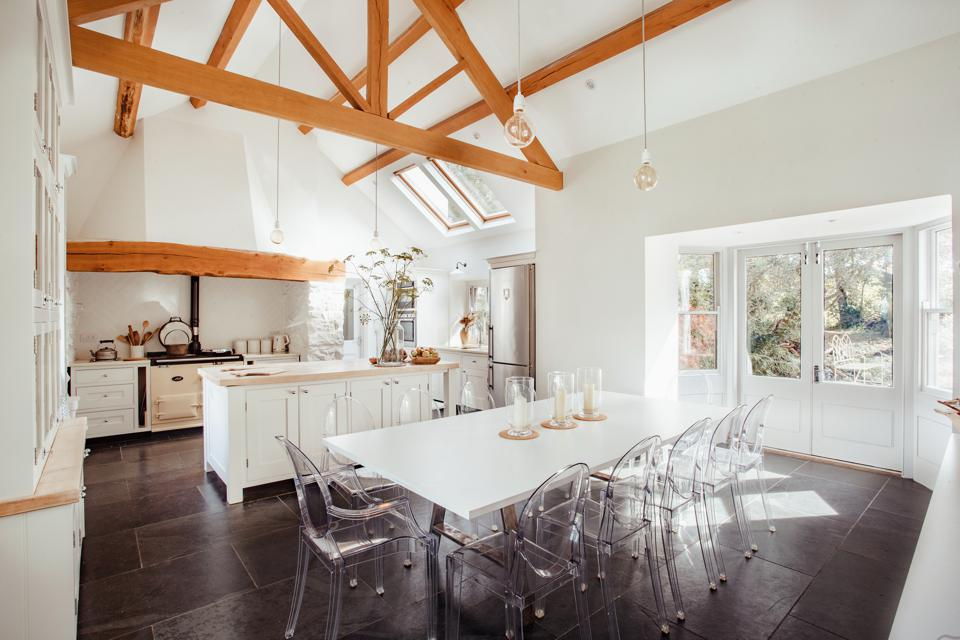 Kitchen/dining room with a pitched ceiling with beams
