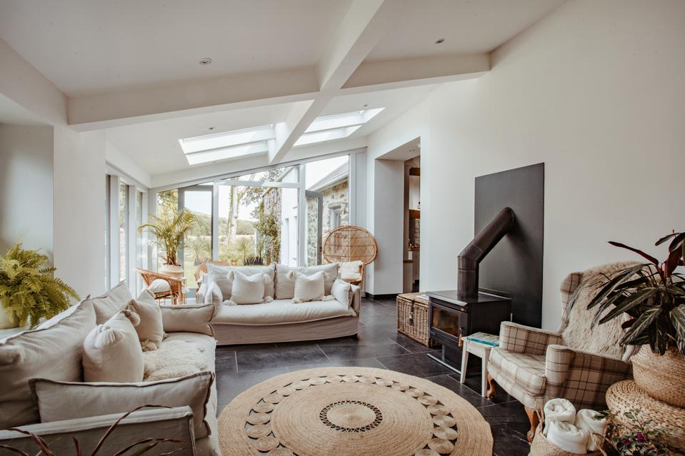 A garden room with skylights and fireplace