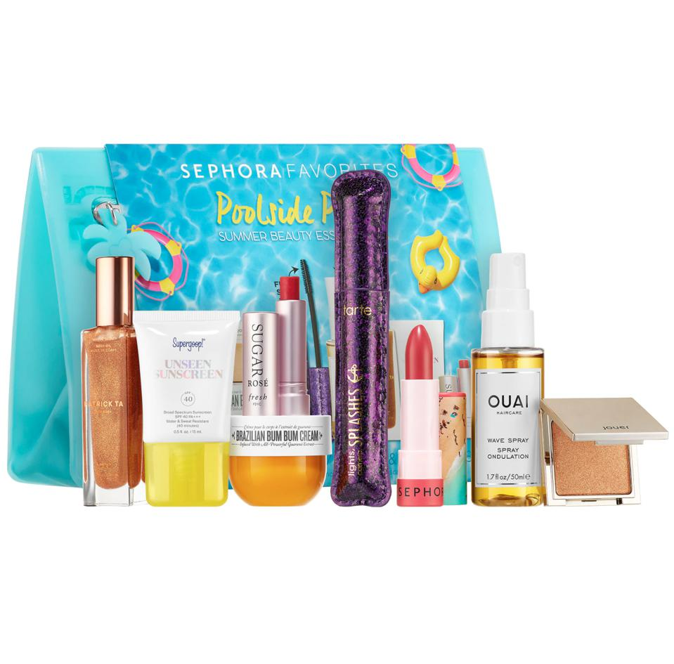 A blue makeup bag with mini sized summer products including sunscreen, mascara, lip gloss
