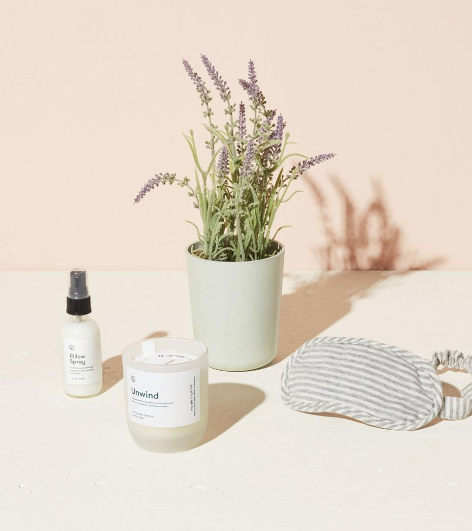 A lavender plant, pillow spray, an eye mask, and a candle