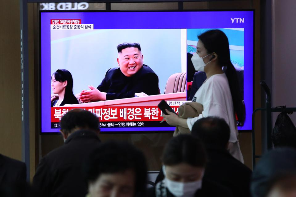 People watch a television broadcast of North Korean leader Kim Jong Un.