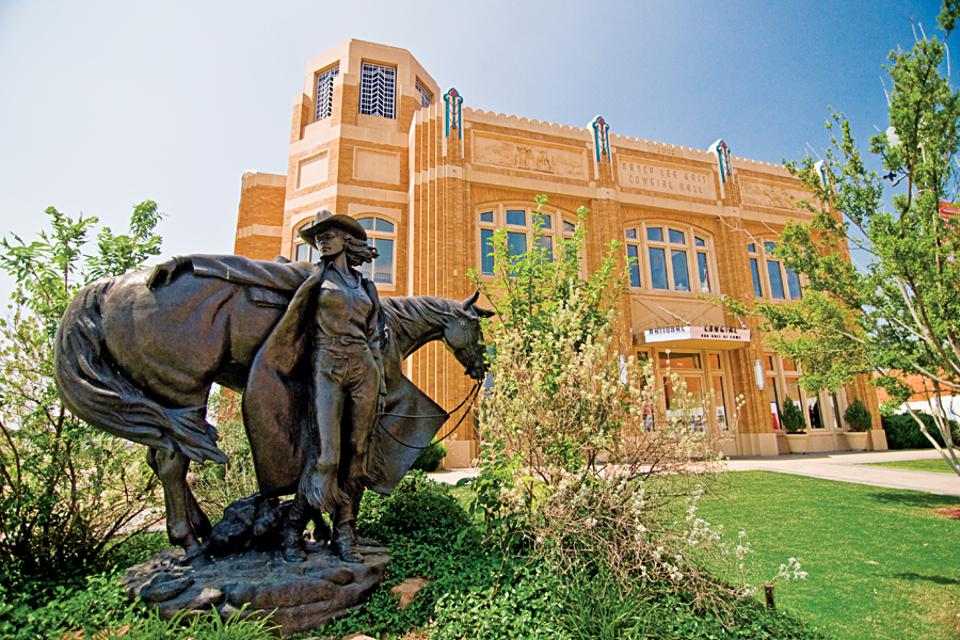 A cowgirl statue in front of Cowgirl Museum of Fort Worth.