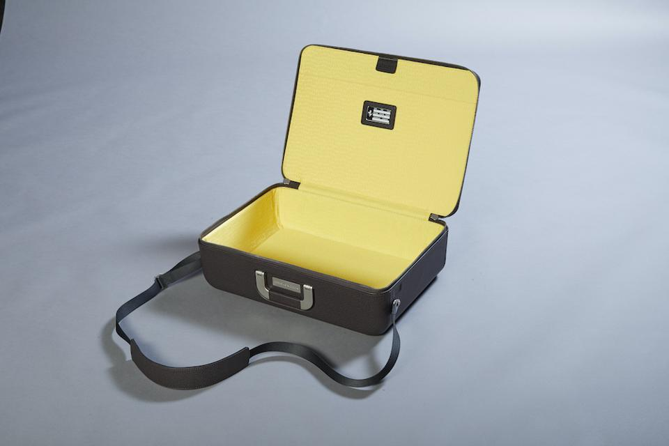 The interior yellow color of the Ferrari luggage line matches Modena's building tradition