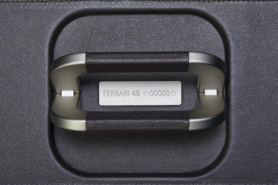 Each product in the Ferrari luggage line designed by Marc Newson has its very own chassis number