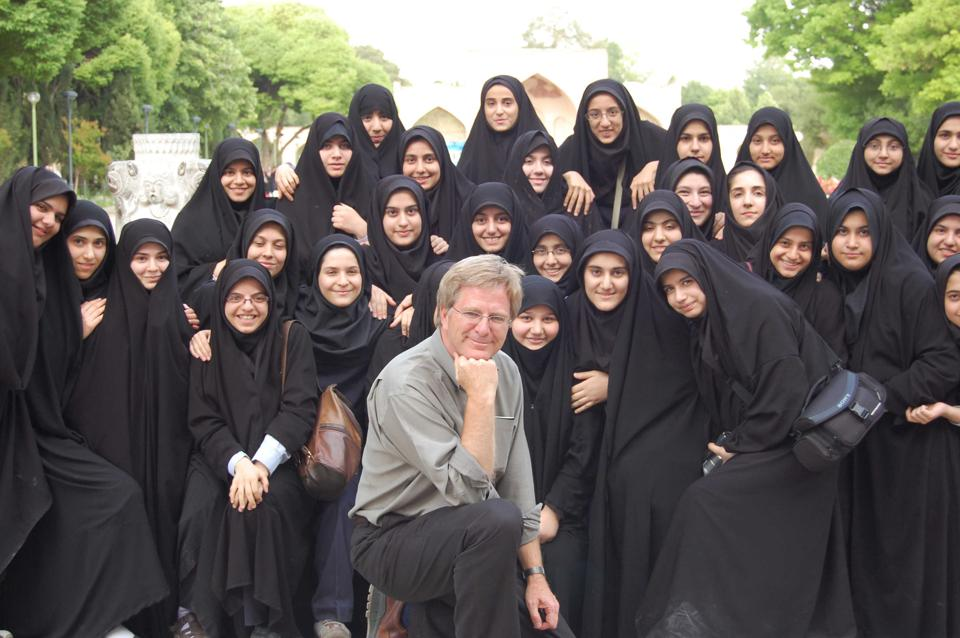 Rick Steves enjoying a moment with school girls in Iran.