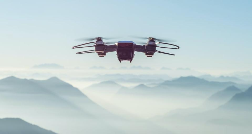 A drone flying in the mountains