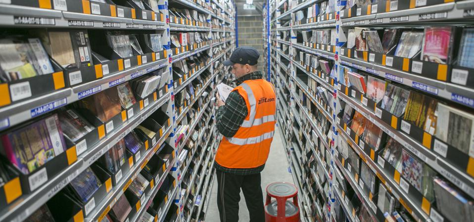 a world of books employee picking orders in a warehouse