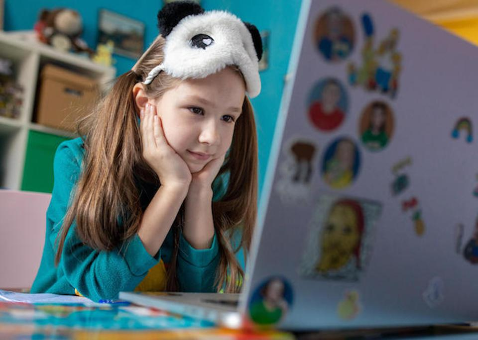On April 15, 2020 in Kyiv, Ukraine, 7-year-old Zlata works on a school assignment from home using the Learning Passport, a global online learning platform developed by UNICEF, Microsoft and the University of Cambridge to help out-of-school children.