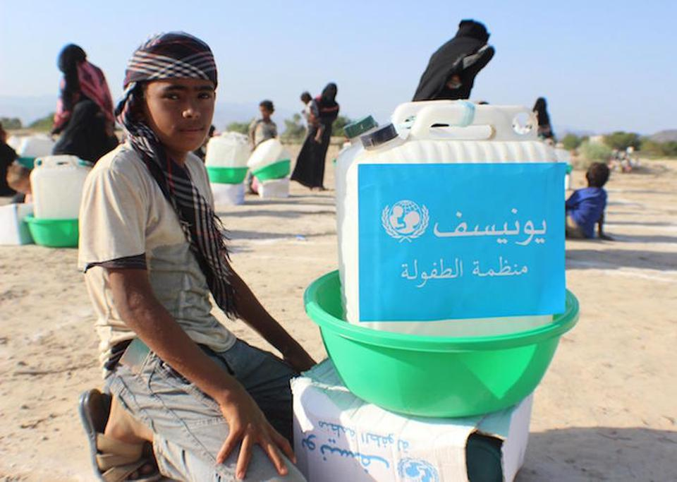 On April 27, 2020 in Abyan, Yemen, families displaced by insecurity collect UNICEF hygiene kits containing soap, laundry detergent, jerry cans for carrying water, buckets and sanitary pads.
