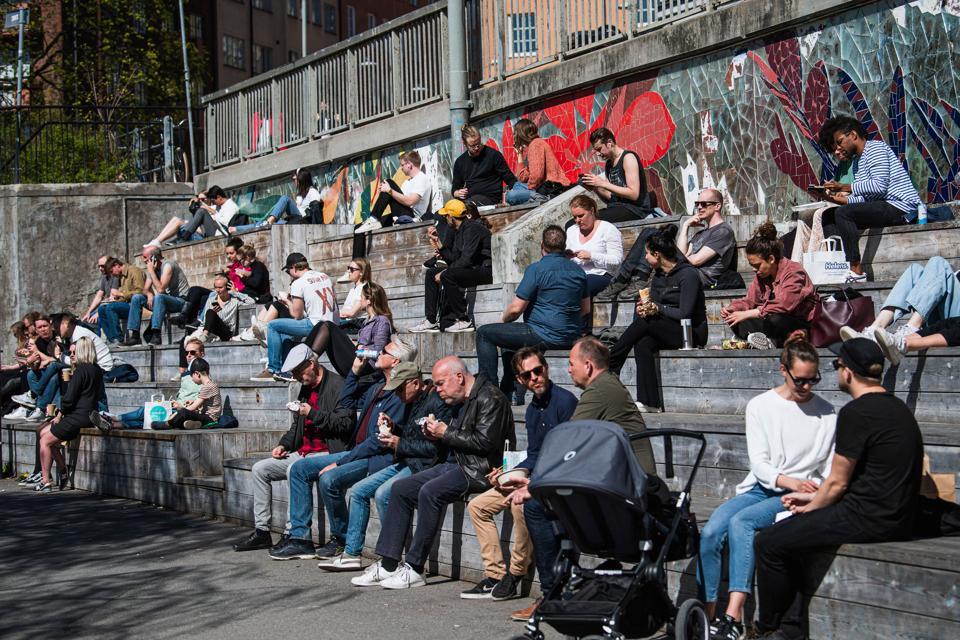 People enjoy the warm spring weather at Hornstull in Stockholm, Sweden.