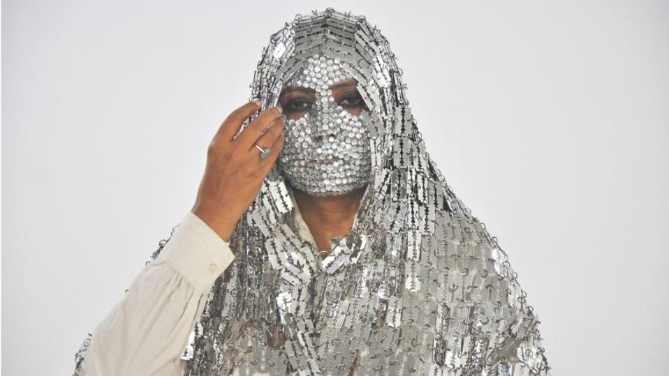 Feminist woman in razor metal hijab