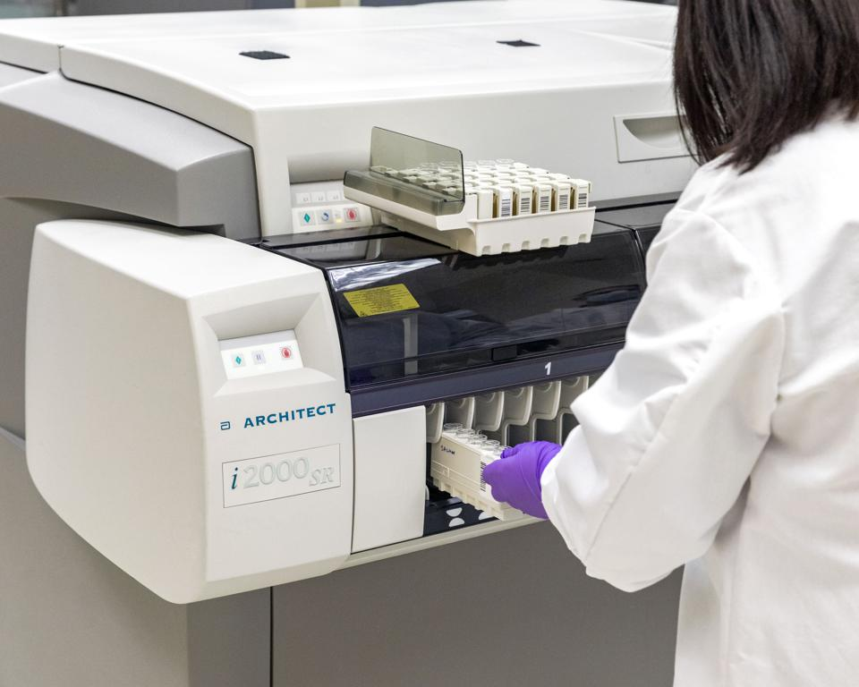 Abbott's lab instruments running the firm's COVID-19 antibody tests.